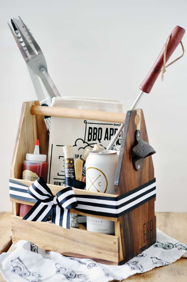 wooden caddy filled with grilling supplies