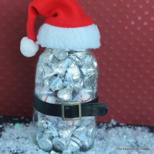 jar filled with chocolates topped with santa hat