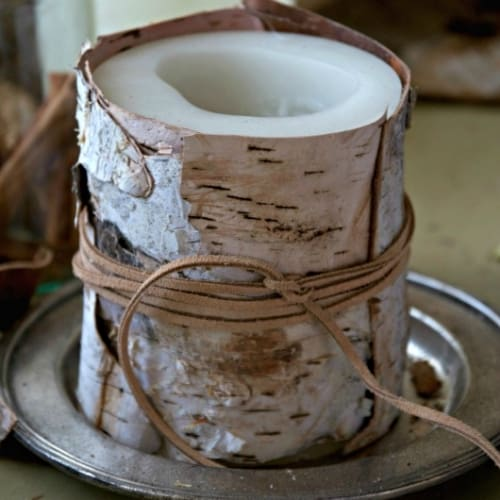 candle wrapped in bark