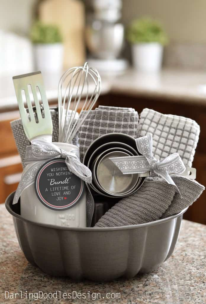 bundt cake pan filled with kitchen towels and utensils