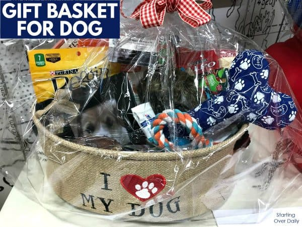 Christmas gift basket ideas-assortment of dog toys and treats in a burlap basket