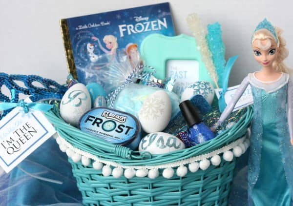 teal basket filled with gifts from Frozen movie