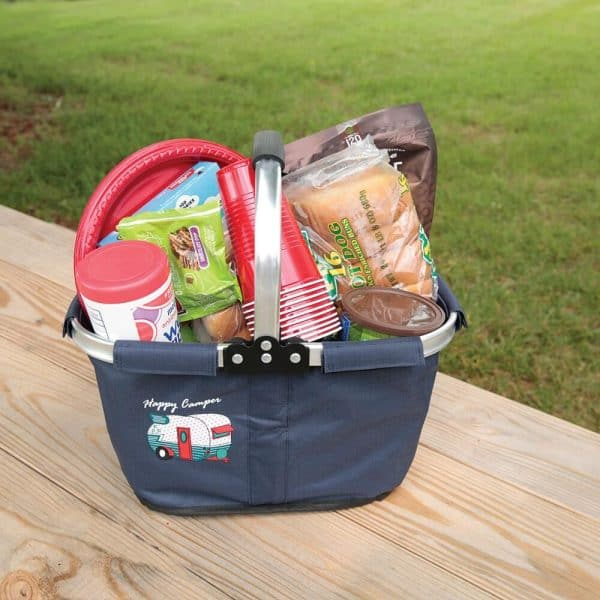 fabric basket filled with picnic supplies