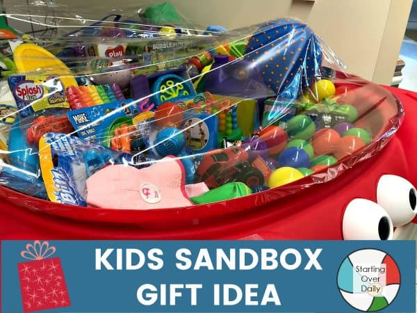 Christmas gift basket ideas-sandbox filled with sand toys