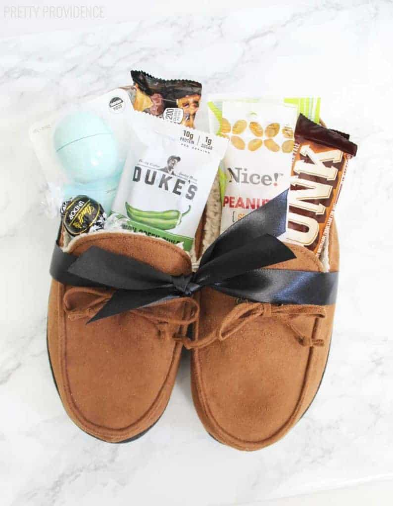 Gift basket ideas-pair of men's slippers filled with snacks