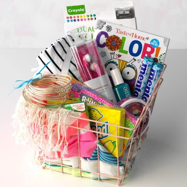 Christmas gift basket ideas-teen magazines, earbuds, craft supplies in a wire bin