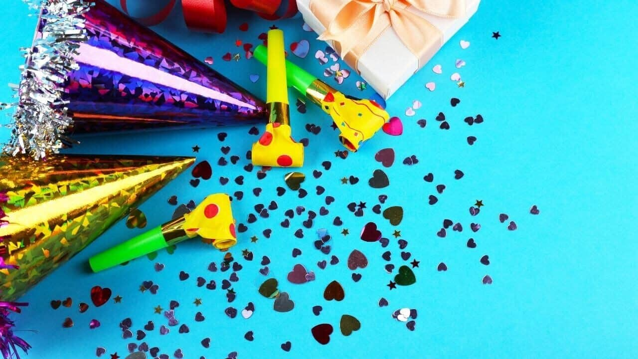 save money on entertainment frugal living tips-party favors on teal background