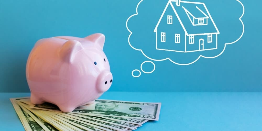 piggy bank standing on cash dreaming of house