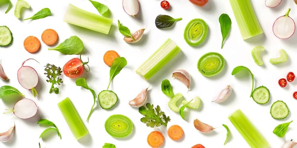 cheap foods to buy when broke-assorted fresh vegetables on white background