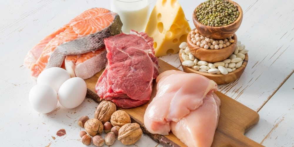 best cheap food to buy when broke-raw meats and proteins on white table top